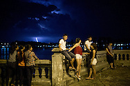 A group of young vietnamese hang out at night on a bridge of Hue, Vietnam, Southeast Asia
