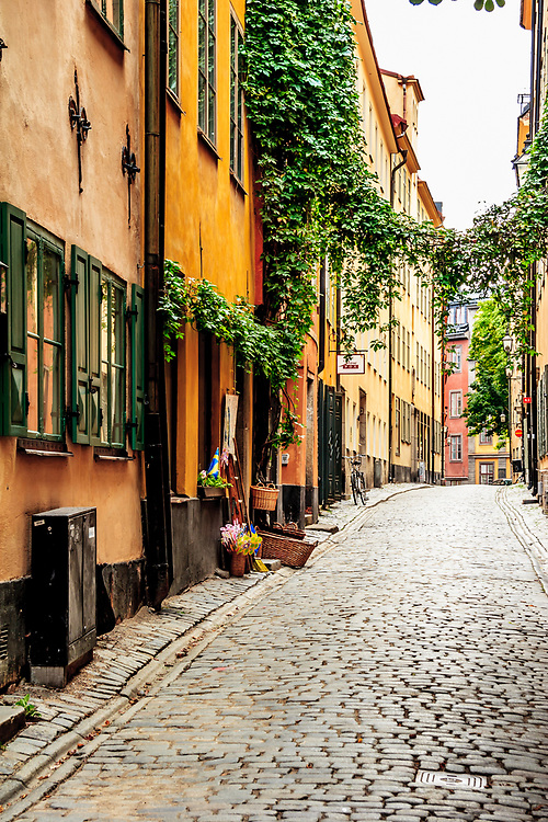The Old Town in Stockholm, Sweden. The Old Town is a brilliant labyrinth of charming cobbled streets, alleyways, faded rust and mustard colored townhouses and meeting squares which remind of north German architecture.