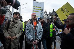 © Licensed to London News Pictures. 29/03/2018. London, UK. Whittleblowers CHRISTOPHER WYLIE and SHAHMIR SANNI wait to speak at a demonstration held by Fair Vote, outside the Houses of Parliament in London, calling for a fair vote on the EU referendum. Whistleblowers Shahmir Sanni and Christopher Wylie both spoke at the event attended by a small number of people.. Photo credit: Ben Cawthra/LNP
