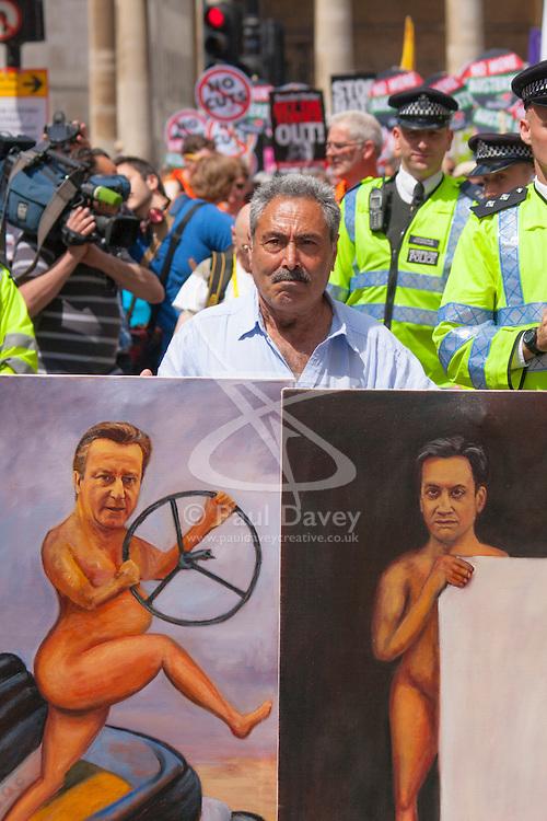 London, June 21st 2014. Artist Kaya Mar displays his latest satirical painting showing Cameron having lost control and Milliband having no visible policies.
