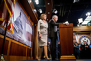 Senate Minority Leader Harry Reid (D-NV) and House Minority Leader Nancy Pelosi (D-CA) arrive to speak to the media about ongoing budget negotiations with the Republican majority during a press conference on Capitol Hill in Washington, D.C., on October 1, 2015.