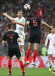 MOSCOW, July 11, 2018  Harry Kane (L top) of England competes for a header with Vedran Corluka of Croatia during the 2018 FIFA World Cup semi-final match between England and Croatia in Moscow, Russia, July 11, 2018. Croatia won 2-1 and advanced to the final. (Credit Image: © Xu Zijian/Xinhua via ZUMA Wire)