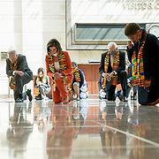 Speaker Nancy Pelosi (D-Calif.) and Democrats kneel to observe a moment of silence for 8 minutes and 46 seconds to honor George Floyd, Breonna Taylor, Ahmaud Arbery and others in Emancipation Hall on Monday, June 8, 2020