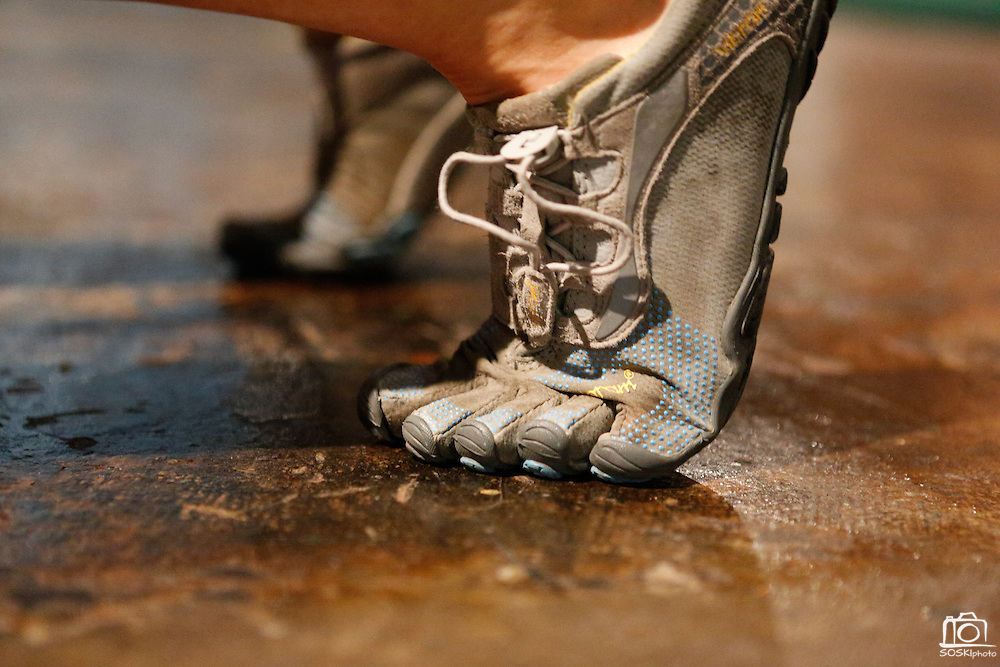 Amy Carenza's Vibram Five Finger shoes grip the floor at the Psycho Gym in Dallas, Texas, on December 20, 2012.  (Stan Olszewski/The Dallas Morning News)