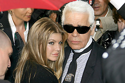 Fergie and Karl Lagerfeld attend Chanel's Haute-Couture Fall-Winter 2008 collection presentation held at 'Parc de Saint-Cloud' near Paris, France on July 3, 2007. Photo by Nebinger-Orban-Taamallah/ABACAPRESS.COM