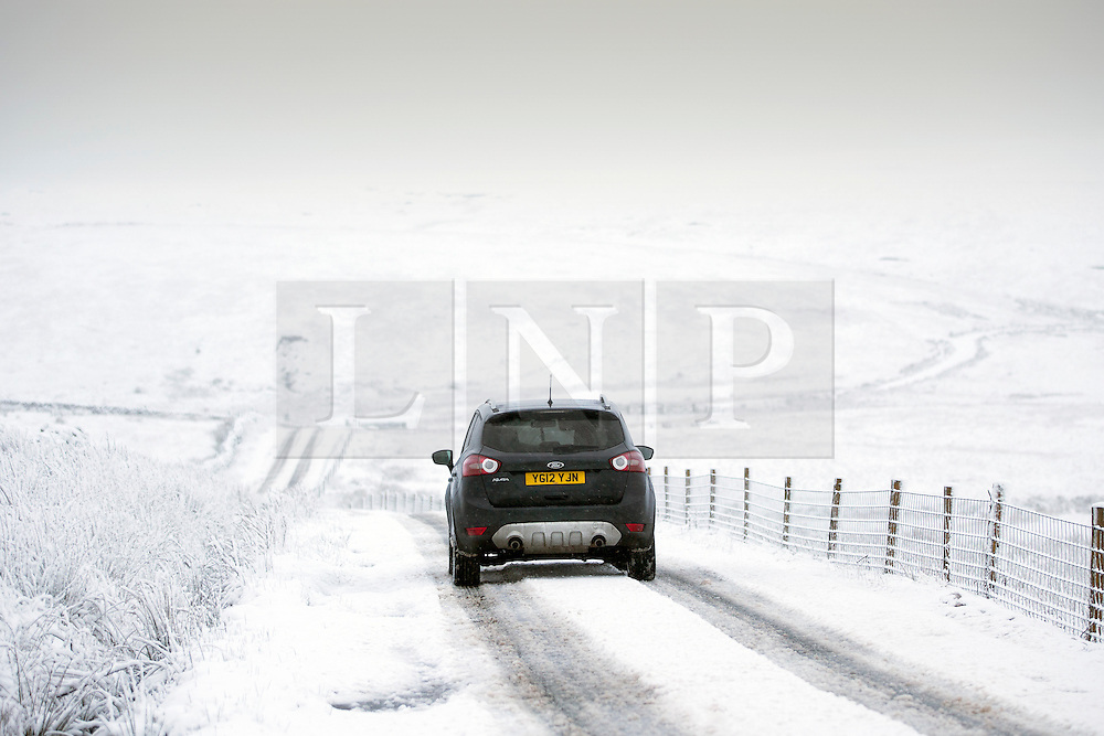 © Licensed to London News Pictures. 14/01/2016. Ribblehead UK. Drivers struggle on the snow covered Newby Head Pass in the Yorkshire Dales Photo credit: Andrew McCaren/LNP