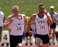 Paul Terek of the United States (201) and Germany's Arthur Abele (189) sprint to the finish of the 100-meter dash, at the Nike Combined Events Challenge at the R.V. Christian Track Complex on the campus of Kansas State University in Manhattan, Kansas, August 5, 2006.