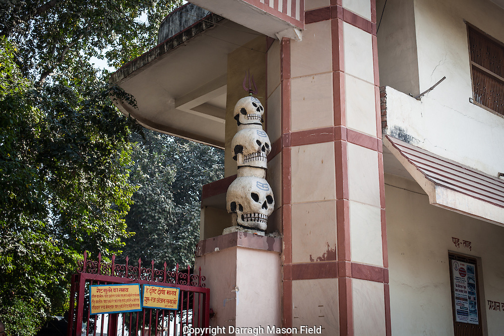 Kinaram ashram in Varanasi is the main location of worship for the Aghori as it is the location of the tomb of Baba Kinaram their patron saint. The entrance to the Ashram is flanked by two columns of concrete skulls stacked on top of each other.