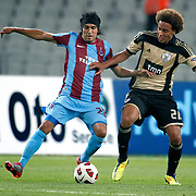 Trabzonspor's Gustavo COLMAN (L) and Benfica's Axel WITSEL (R) during their UEFA Champions League third qualifying round, second leg, soccer match Trabzonspor between Benfica at the Ataturk Olimpiyat Stadium at İstanbul Turkey on Wednesday, 03 August 2011. Photo by TURKPIX