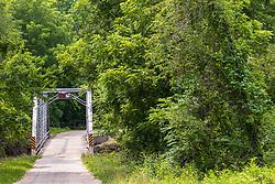 Swisher Bridge is an old steel bridge with a wooden deck over a Swisher Creek near Clinton Illinois .