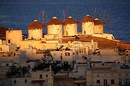 Sunrise over the  traditional Greek windmills of Mykonos Chora. Cyclades Islands, Greece