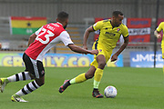 Luke Croll and Tyrone Barnett  during the EFL Sky Bet League 2 match between Exeter City and Cheltenham Town at St James' Park, Exeter, England on 22 September 2018.