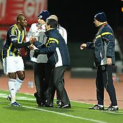 Fenerbahce's coach Aykut Kocaman (C) and Moussa Sow (L) during their Turkish Super League soccer match MP Antalyaspor between Fenerbahce at the Ataturk stadium in Antalya Turkey on Sunday 17 March 2013. Photo by TURKPIX