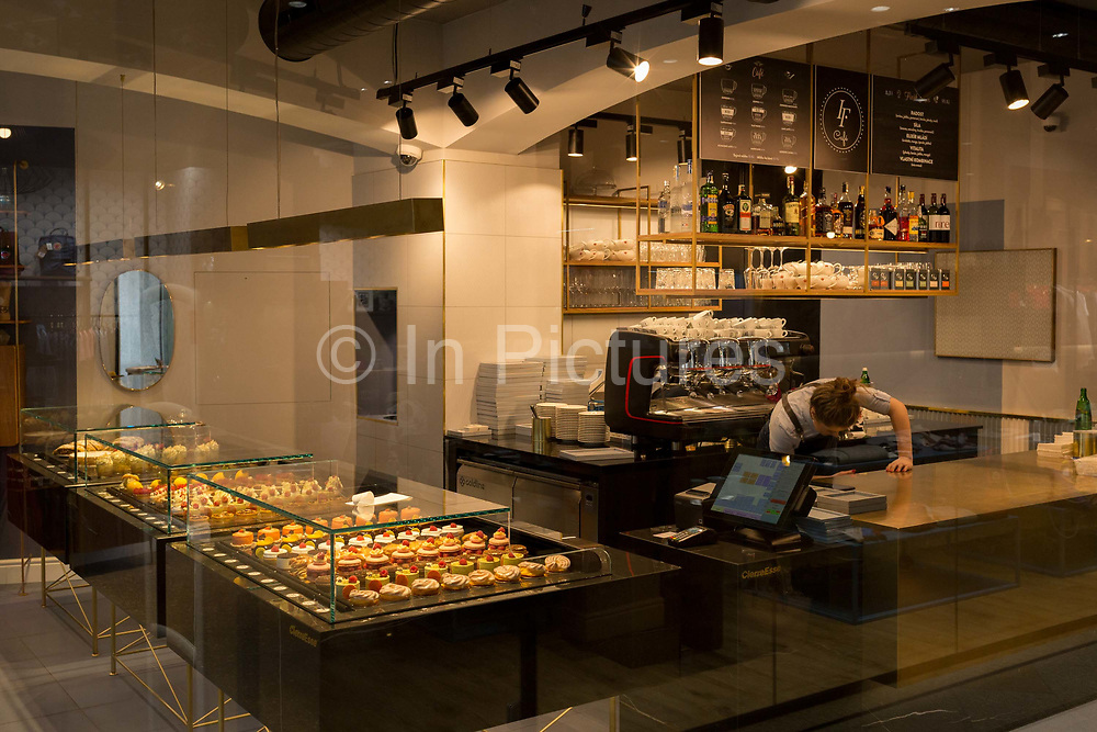 Staff work behind the counter of a smart cafe in the centre of the Czech cacapital, on 19th March, 2018, in Prague, the Czech Republic.