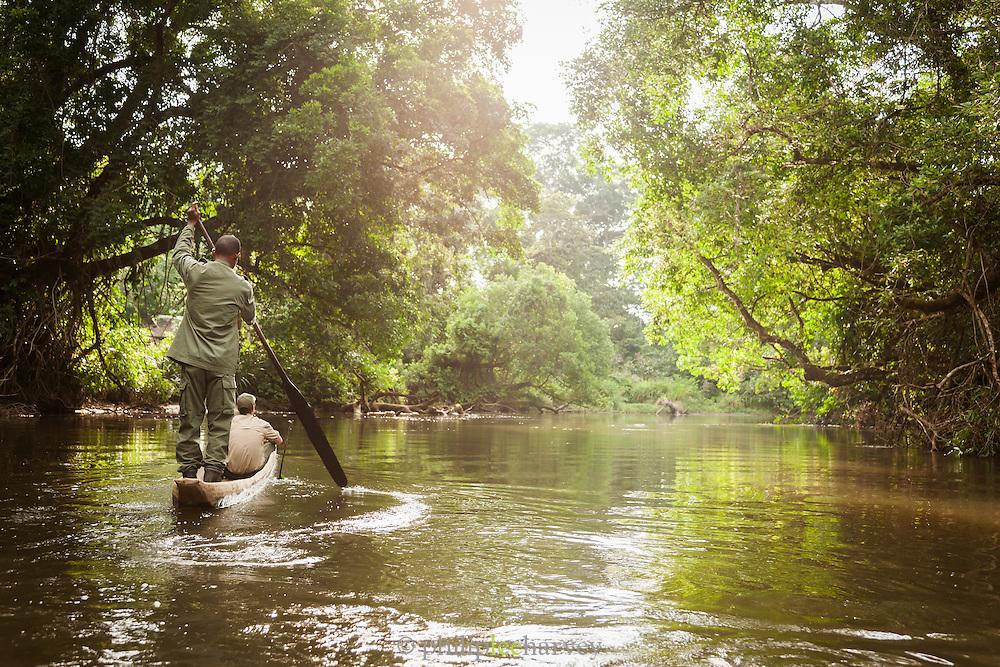 Men Canoeing the Lekoli River.