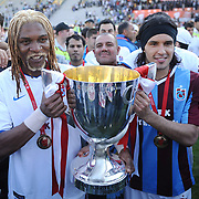 Jubilant Trabzonspor players Rigobert Song BAHANAG (L) and Gustavo COLMAN (R) lifting up the cup at the ceremony during their after the Turkey Cup final match Trabzonspor between Fenerbahce at the GAP Arena Stadium at Urfa Turkey on wednesday, 05 May 2010. Photo by TURKPIX