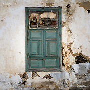 A window blocked by stone in an historic building in Teguise town in Lanzarote