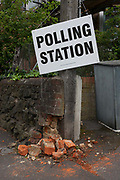 Damaged bricks on the wall outside a polling station on the morning of the UK 2017 general elections in Half Moon Lane, Dulwich, on 8th June 2017, in London, England.