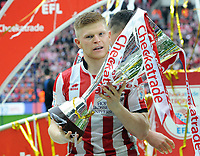Football - 2018 Checkatrade (EFL) Trophy - Lincoln City vs. Shrewsbury Town<br /> <br /> Lincoln goalscorer, Elliot Whitehouse celebrates with the trophy, at Wembley Stadium.<br /> <br /> COLORSPORT/ANDREW COWIE