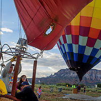 Pilot Steve Adams gets ready to launch his hot air balloon during the Zuni Fair Saturday in Zuni.