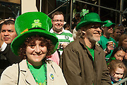 Parade watchers in green hats