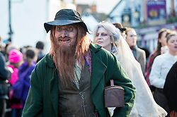 © Licensed to London News Pictures. 02/12/2018. ROCHESTER, UK. A participant dressed as Fagin takes part in the annual Dickensian Christmas Festival in Rochester.  The Kent town is given a Victorian makeover to celebrate the life of the writer Charles Dickens (who spent much of his life there), with Victorian themed street entertainment, costumed parades and a Christmas market.  Photo credit: Stephen Chung/LNP