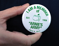 Golf fan Andrew McGovern wears a Arnie's Army button, given out to patron entering the grounds, during the honorary start of the Masters that included a tribute to the late Arnold Palmer at Augusta National Golf Club on Thursday, April 6, 2017, in Augusta, Ga. (Photo by Curtis Compton/Atlanta Journal-Constitution/TNS)  *** Please Use Credit from Credit Field ***