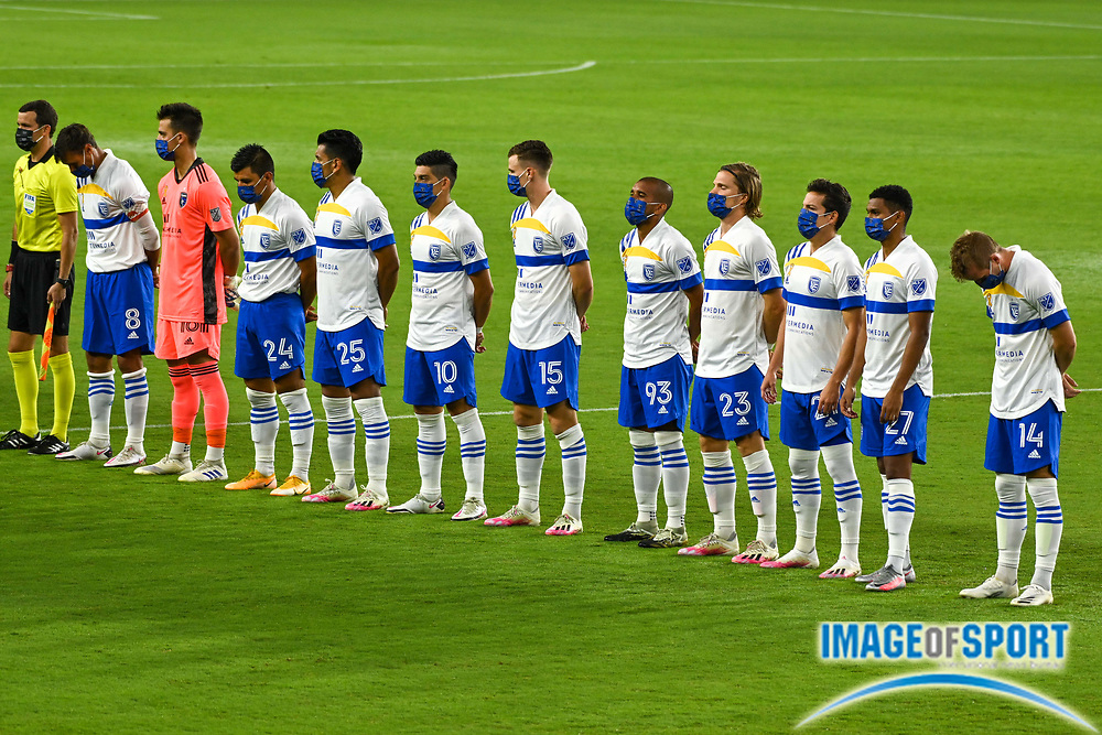 San Jose Earthquakes players stand in a moment of silence in honor of the firefighters lost in recent California wildfires, before a MLS soccer game, Sunday, Sept. 27, 2020, in Los Angeles. The San Jose Earthquakes defeated LAFC 2-1.(Dylan Stewart/Image of Sport)