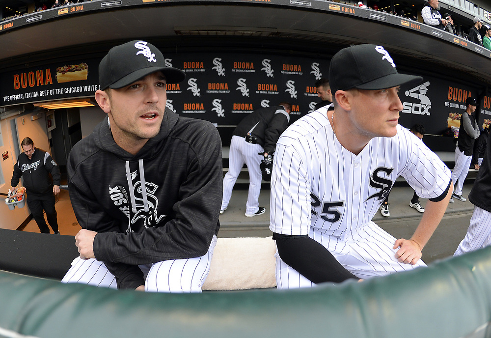 CHICAGO - APRIL 04:  David Robertson #30 and Cody Asche #25 of the Chicago White Sox look on in the dugout prior to the game against the Detroit Tigers on April 04, 2017 at Guaranteed Rate Field in Chicago, Illinois.  The Tigers defeated the White Sox 6-3.  (Photo by Ron Vesely)   Subject:  David Robertson; Cody Asche