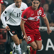Turkey's Mehmet TOPUZ (R) and Austria's Marko ARNAUTOVIC (L) during their UEFA EURO 2012 Qualifying round Group A soccer match Turkey betwen Austria at Sukru Saracoglu stadium in Istanbul March 29, 2011. Photo by TURKPIX
