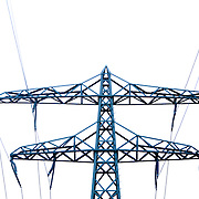 Electric pylons and wires against clear sky
