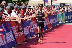 21.06.2014, Remich, LUX, Ergo Ironman 70.3, im Bild Der Schweizer Manuel Kueng feiert seinen vierten Platz mit den Zuschauern // during the Ergo Ironman 70.3 in Remich, Luxembourg on 2014/06/21. EXPA Pictures © 2014, PhotoCredit: EXPA/ Eibner-Pressefoto/ Schueler<br /> <br /> *****ATTENTION - OUT of GER*****
