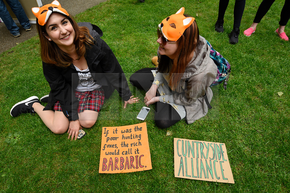 """© Licensed to London News Pictures. 29/05/2017. London UK. Demonstrators wearing fox masks join an """"Anti-Hunting March"""" in central London, marching from Cavendish Square to outside Downing Street.  Protesters are demanding that the ban on fox hunting remains, contrary to reported comments by Theresa May, Prime Minister, that the 2004 Hunting Act could be repealed after the General Election.<br />  Photo credit : Stephen Chung/LNP"""