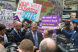 """Smith Square, Westminster, London, June 16th 2016. UKIP leader Nigel Farage launches his """"biggest ever"""" advertising campaign as Leave and Remain enter their last week of campaigning before the EU referendum on June 23rd. PICTURED: Farage speaks to the media as Remain campaigners get their posters in front of the cameras."""