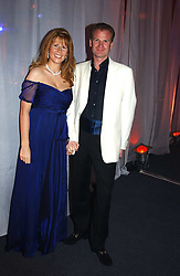 AURELIA STEPHENSON and her husband MR RUPERT STEPHENSON at the Conservative Party Summer Party held at the Shepards Bush Pavillion, Shepards Bush, London on 13th May 2004.<br /> <br /> Photo by Dominic O'Neill/Desmond O'Neill Features Ltd.  +44(0)1306 731608  www.donfeatures.com