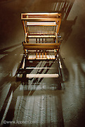 A weaving loom photographed on a custom made background.