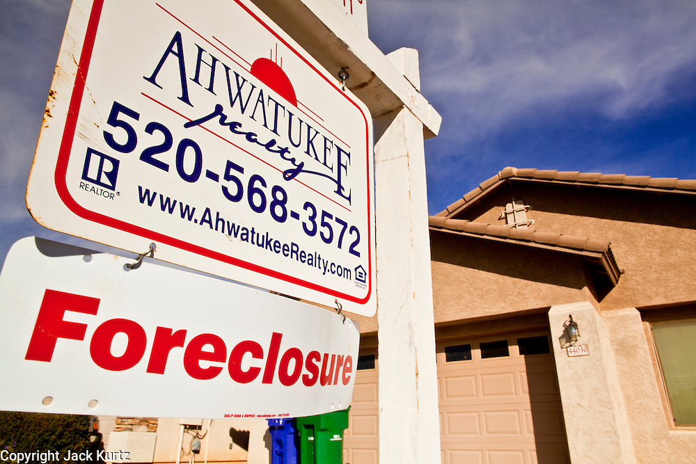 """26 DECEMBER 2010 - MARICOPA, AZ: A foreclosed home for sale one block from the home BRISTOL PALIN, 20, bought in Maricopa, AZ, for $172,000. The former contestant on """"Dancing with the Stars"""" and daughter of Sarah Palin, former governor of Alaska, former Republican Vice Presidential candidate, reality television star, best selling author and supporter of the Tea Party movement. Bristol Palin paid $172,000 cash for the two-level, 3,900-square-foot, brown stucco house with a tile roof, 2 1/2 baths, a three-car garage, landscaped front and back yards, and access to a community pool. Local media reported that the home was built in 2006, at the peak of the Arizona real estate boom, and was bought for a little under $330,000 at the time. According to paperwork filed with the Pinal County Recorder's Office, Palin closed on the home in early December, buying it from Michael and Cynthia Smith, North Dakota investors who bought the home when it was in foreclosure. The home is in the Cobblestone Farms development in Maricopa, about 40 miles from Phoenix. Maricopa was a small farming community until the late 1990's when land speculators starting buying up the farms and turning them into subdivisions. Growth in Maricopa boomed from 2002 until 2008 when the recession, foreclosure and banking crisis hit. Since then it has had one of the highest foreclosure rates in the United States. Now investors are starting to buy foreclosed homes in Maricopa, anticipating the end of the foreclosure crisis. Homes in Maricopa are now selling for about less than half of what they cost in 2006. Bristol Palin has not commented publicly on the purchase and has not said if the home is an investment or if she plans to live in it. PHOTO BY JACK KURTZ"""