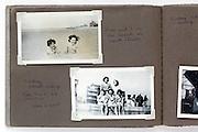 family photo album page with beach scene England 1950s