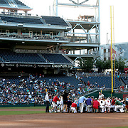 Members of the Democrat and Republican baseball teams pray prior to the Congressional Baseball Game on Thursday, June 15, 2017.