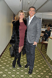 LISA TCHENGUIZ and STEVE VORSARI at the Hennessy Gold Cup at Newbury Racecourse, Berkshire on 26th November 2011.