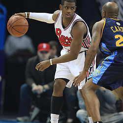 28 January 2009:  New Orleans Hornets guard Chris Paul (3) is defended by Anthony Carter (25) during a 94-81 win by the New Orleans Hornets over the Denver Nuggets at the New Orleans Arena in New Orleans, LA. The Hornets wore special throwback uniforms of the former ABA franchise the New Orleans Buccaneers for the game as they honored the Bucs franchise as a part of the NBA's Hardwood Classics series. .