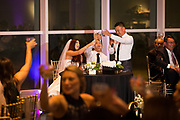 Bride and groom celebrate their wedding with family and friends at The Crocker Museum in Sacramento, California, on August 6, 2016. (Stan Olszewski/SOSKIphoto for Gary Sexton)