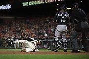 San Francisco Giants third baseman Eduardo Nunez (10) goes down during a Colorado Rockies pitch at AT&T Park in San Francisco, California, on April 14, 2017. (Stan Olszewski/Special to S.F. Examiner)