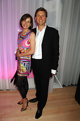 DARCEY BUSSELL and her husband ANGUS FORBES at the Lauren-Perrier 'Pop Art' Pink Party in aid of Capital 95.8's Help A London Child, held at Suka at the Sanderson Hotel, 50 Berners Street, London W1 on 25th April 2007.<br /><br />NON EXCLUSIVE - WORLD RIGHTS
