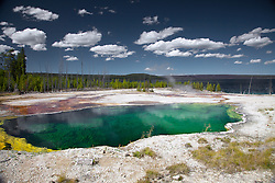 Abyss Pool is a colorful and interesting pool in the West Thumb Geyser Basin. Abyss is the deepest pool known in Yellowstone and received its name for its abyss-like depth. The dark green-colored water gives the illusion of a bottomless pool.