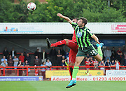 Jon Meades winning the header during the Sky Bet League 2 match between Crawley Town and AFC Wimbledon at the Checkatrade.com Stadium, Crawley, England on 15 August 2015. Photo by Michael Hulf.