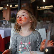 SIENA, ITALY - OCTOBER 26: A three year old girl eating home made pasta in a restaurant in The Piazza del Campo in Siena, Italy. Siena is a city in central Italy's Tuscany region, is distinguished by its medieval brick buildings. The fan-shaped central square, Piazza del Campo, is the site of the Palazzo Pubblico, the Gothic town hall, and Torre del Mangia, a slender 14th-century tower with sweeping views from its distinctive white crown. Siena, Italy. 26th October 2017. Photo by Tim Clayton/Corbis via Getty Images)