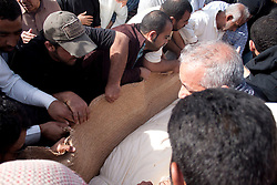 © under license to London News Pictures.  18/02/2011. People bury Ali Al Almoumen, the third person to be buried in Sitra today after he was killed on Wednesday at the Pearl Roundabout.  Photo credit should read Michael Graae/London News Pictures