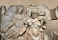 Close up of a Roman Sebasteion relief  sculpture of Aineas' flight from Troy, Aphrodisias Museum, Aphrodisias, Turkey.  Against an art background.<br /> <br /> Aineas in armour carries his aged farther Anchises on his shoulders and leads his young son Lulus by his hand. They are fleeing from the sack of Troy. The figure floating behind is Aphrodite, Aineas' mother: she is helping their escape. Old Anchises carries a round box that held images of Troy's ancestral gods. .<br /> <br /> If you prefer to buy from our ALAMY STOCK LIBRARY page at https://www.alamy.com/portfolio/paul-williams-funkystock/greco-roman-sculptures.html . Type -    Aphrodisias     - into LOWER SEARCH WITHIN GALLERY box - Refine search by adding a subject, place, background colour, museum etc.<br /> <br /> Visit our ROMAN WORLD PHOTO COLLECTIONS for more photos to download or buy as wall art prints https://funkystock.photoshelter.com/gallery-collection/The-Romans-Art-Artefacts-Antiquities-Historic-Sites-Pictures-Images/C0000r2uLJJo9_s0