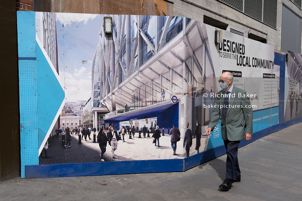 An elderly pensioner who qualifies for a TFL freedom Pass, walks past the billboards promoting Crossrail's new Queen Elizabeth rail line, the capital's newest on 4th September 2020, on Moorgate in London, England. Crossrail's Elizabeth Line is a 118-kilometre (73-mile) railway line under development in London and the home counties of Berkshire, Buckinghamshire and Essex, England. Crossrail is the biggest construction project in Europe and is one of the largest single infrastructure investments ever undertaken in the UK . Delays and setbacks to the scheme, running three years late is now £3.4 billion over budget to its initial £14.8bn price tag.